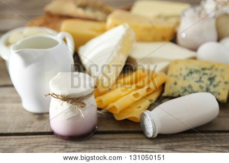 Set of fresh dairy products on old  wooden table, close up