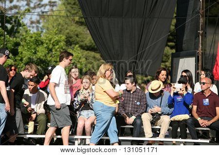 IRVINE, CALIFORNIA - May 22: Special Fans and Supporters arrive on stage of the Irvine Meadows Amphitheater for Bernie Sanders at a Rally in Irvine, California on May 22, 2016