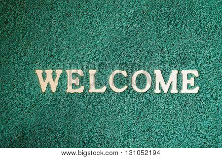 Close up door mat with welcome word