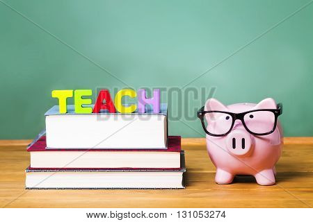 Teaching Theme With Pink Piggy Bank On Top Of Books With Chalkboard In The Background