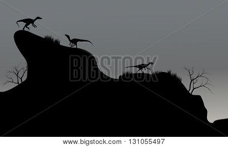 eoraptor in cliff silhouette at night with gray backgrounds