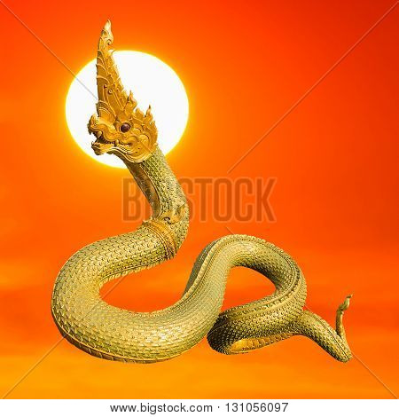 Naga Thai statue with beautyful sunset background