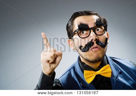 Funny man against dark background