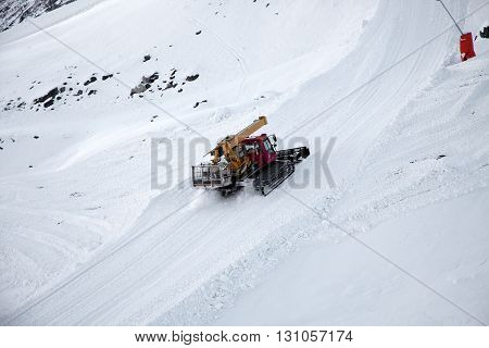 Snow removal (plow) machine near Zermatt Switzerland