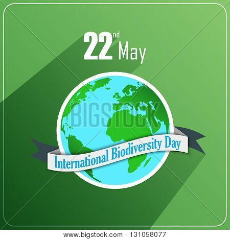 Vector illustration of International Biodiversity Day concept with globe and ribbon on green background