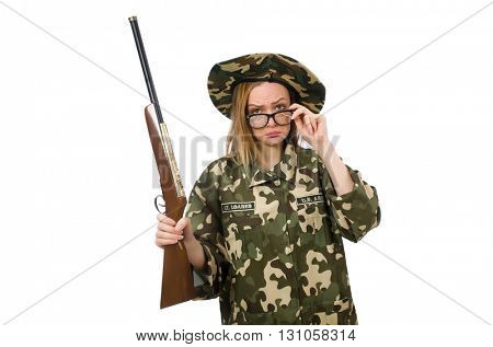 Girl in military uniform holding the gun isolated on white