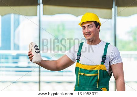 Young construction worker working at the site