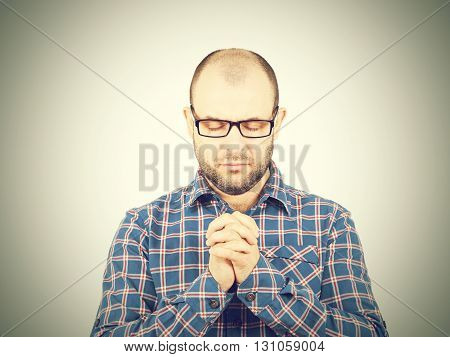 Man Prays With His Eyes Closed.