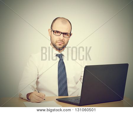 Business Man Working At A Computer.