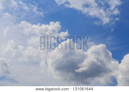 White fluffy clouds in the blue sky. Synoptics. Good weather