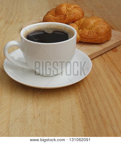 Cup of coffee and Croissant Breakfast Fast.