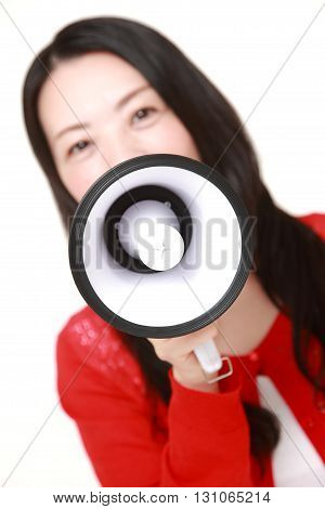 portrait of woman with megaphone on white background