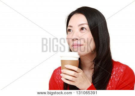 portrait of Japanese woman takes a coffee break on white background