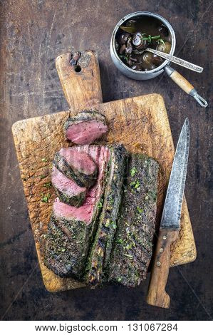 Barbecue Saddle of Venison on Cutting Board