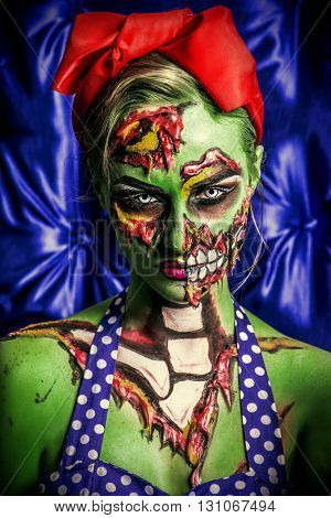 Glamorous zombie girl. Portrait of a pin-up zombie woman. Body-painting project. Halloween make-up.