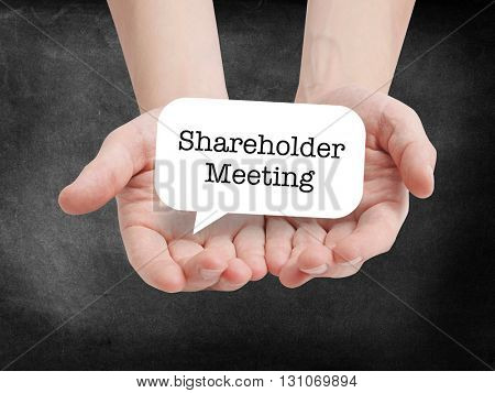 Shareholder Meeting written on a speechbubble