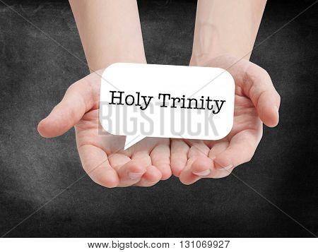Holy Trinity written on a speechbubble