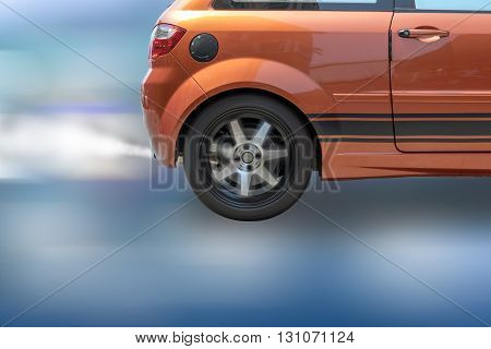 The smoke caused by the friction of tires on the road surface when the wheel rotational speeds.