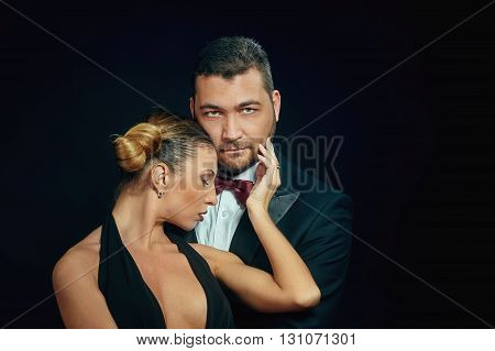 Portrait of a young attractive couple on a dark background