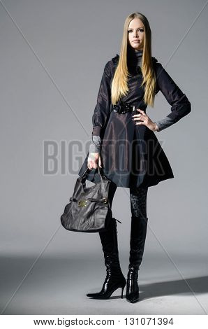 Full body Portrait of a styled professional model on gray background