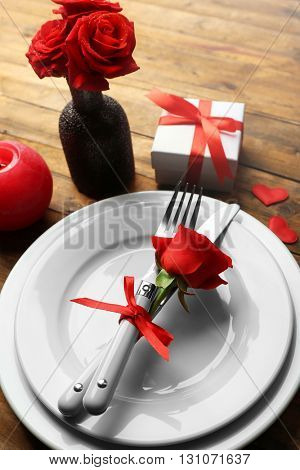 Festive table setting for Valentines Day on wooden table background