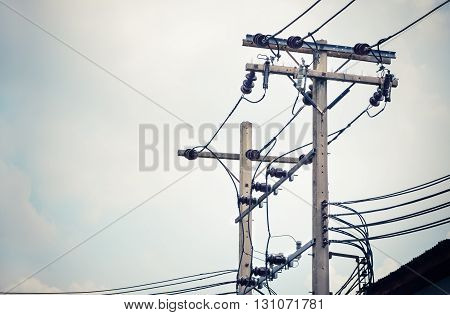 Vintage color filter / Electric pillar with transformer in the electric network in Bangkok, Thailand, with place for your text