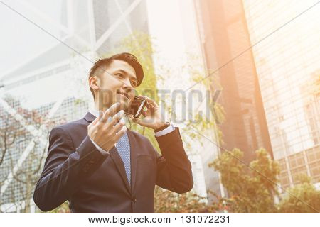 Asian businessman talk to cellphone