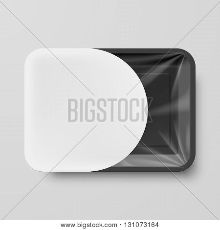 Empty Black Plastic Food Container with White Label on Gray