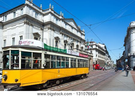 Milan Italy - April 12 2012: A tram in front of the Scala theater