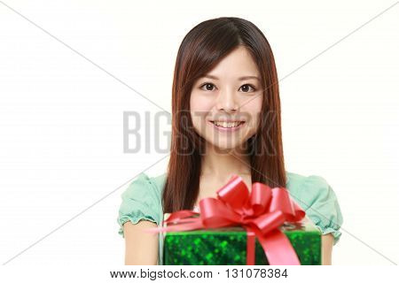 young Japanese woman offering a gift on white background