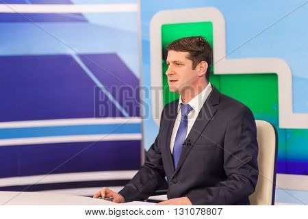 Male anchorman in tv studio. Live broadcasting