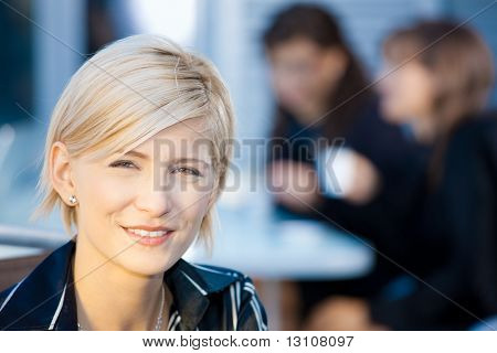 Closeup portrait of attractive young businesswoman, smiling.