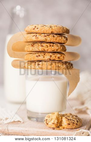 Stack of cookies on milk glass, closeup, toned