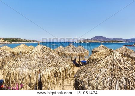 View of the bay and the sun umbrella on the Greek island of Crete