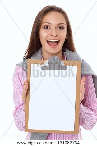 Studio portrait of a confident young female professional holding a clipboard