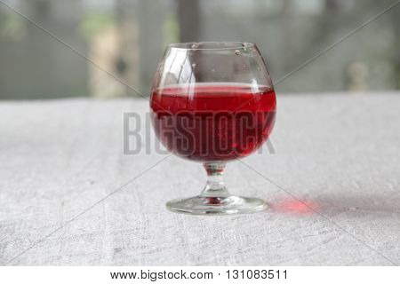 red wine in a transparent glass on the table