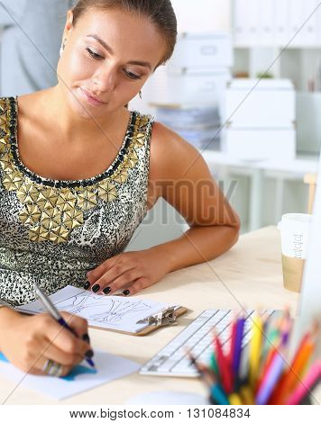 Young creative designer drawing a sketch in an open plan office space