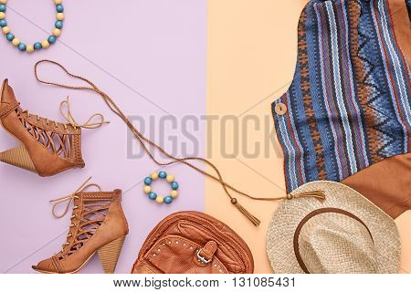Cowboy street style Fashion girl clothes accessories set. Hipster woman, trendy handbag, shoes, straw hat, necklace. Urban country creative outfit. Overhead, top view on pink yellow