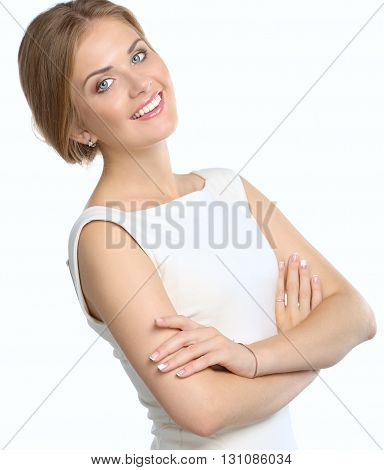 Studio portrait of a beautiful young woman standing against a white background.