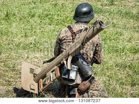 NITRA SLOVAK REPUBLIC - MAY 21: Reconstruction of the Second World War operations between Red and German army german soldier with armor-fist is looks around the battlefield on May 21 2016 in Nitra Slovak Republic.