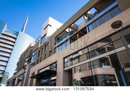 Milan Italy - January 26 2015: Porta Nuova the Corso Como residence with the Unicredit Tower in the backgound