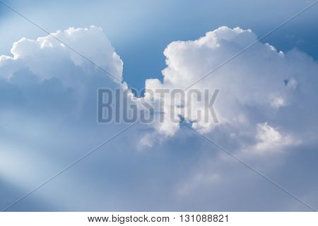 Big clouds and light beam in day light