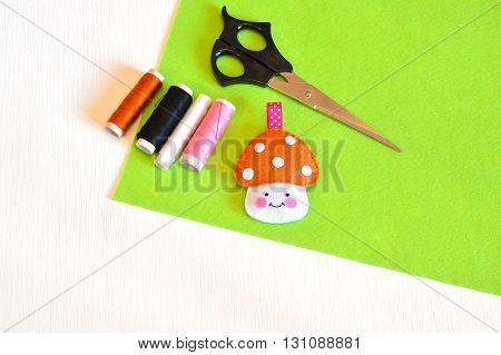 Felt toy mushroom, thread, needle, scissors. Tutorial. Сraft concept