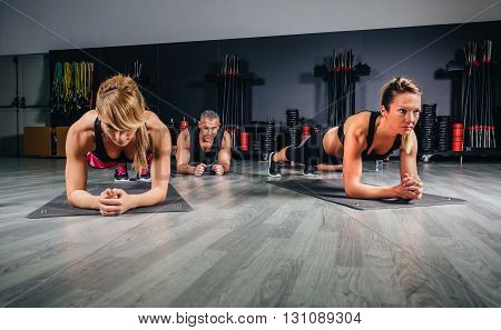 People doing push ups in fitness class on sports center