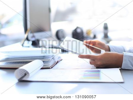 Businesswoman hands with touchpad in modern office