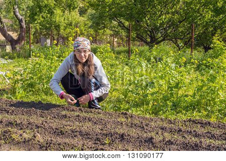 Woman farmer working in the field. We sometimes have funny face when we think.