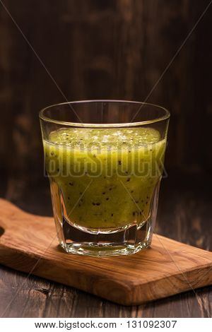 Green refreshing smoothie with kiwi, cucumber and apple. Toned image. Selective focus