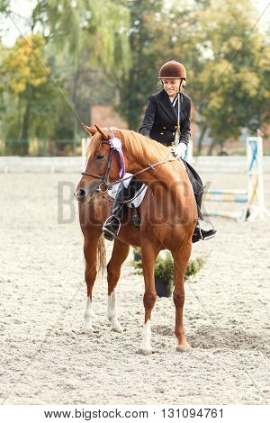 Teenage Girl Winning In Equestrian Competition