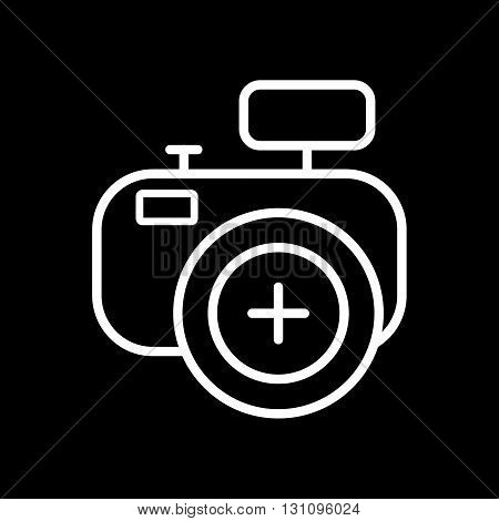 Photo camera vector icon isolated on a black background.