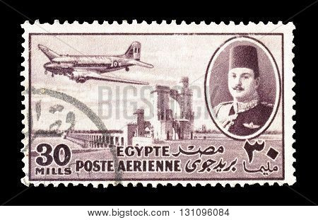 EGYPT - CIRCA 1947 : Cancelled postage stamp printed by Egypt, that shows king Farouk Delta Dam and airplane.